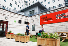 Unite posts half year profit fall but hikes dividend